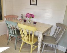This fabulous dining set has four pastel chairs painted in Duck Egg Blue, Paris Grey, Antoinette and Yellow.  The table is in Original White with gunmetal grey showing through underneath.  The whole set is painted with a textured effect and heavily aged and distressed with dark wax.  If you're looking for a stand-out country set, this is it!