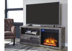 Fall in love with the Derekson Multi LG TV Stand with Glass/Stone Fireplace Insert by Signature Design by Ashley at Furniture City proudly serving Fresno, CA and surrounding areas! Tv Stand With Fireplace Insert, Electric Fireplace Tv Stand, Fireplace Inserts, Buffalo S, Swivel Tv Stand, Tv Furniture, Furniture Buyers, Furniture Websites, Country Furniture