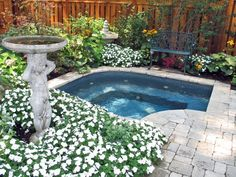 built in ground hot tob in white stones, surround by wood fence of Marking Your Private Space, Enjoying Your Time in Hot Tub