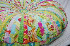 Scrappy Floor Pillow  http://www.livingwithpunks.com/2011/11/made-jelly-roll-floor-pillow.html