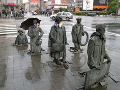 These incredible sculptures in Wroclaw, Poland are half of a set that extend across the block (these ones rising out from below the pavement, the others sinking back in). Description from distractify.com. I searched for this on bing.com/images