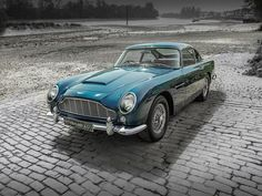 The Aston Martin is one of the most elegant grand tourer supercars available. Available in a couple or convertible The Aston Martin has it all. British Sports Cars, Classic Sports Cars, Classic Cars, Classic Aston Martin, Aston Martin Vanquish, Jaguar, Cars For Sale Uk, Classic Car Restoration, Classic Motors