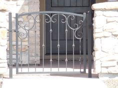 What about a little iron gate on the front porch? Pin it.