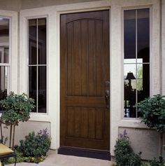 Let your exterior style set you apart from your neighbors. Add timeless, old world sophistication to your entry with a mahogany stained door.