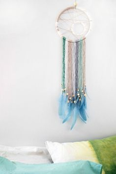 Modern Dreamcatcher -- If you love the delicate, boho style of a dreamcatcher, here are 10+ dreamcatcher tutorials for you to try to make your own!