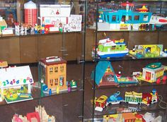 Vintage Fisher Price toys.  My mom and aunties put them away when we grew up, now they're back for our children!
