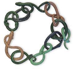 Leslie Blackford. Leslie loves snakes and she doesn't see this necklace of polymer links as alarming at all.