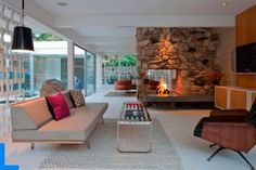 Architecture, Luxury Modern House with Warm Shadow: Comfortable Family Room With Fireplace As The Room Divider