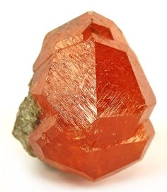 Spessartine Garnet cluster in stunning tangerine orange color, lustrous and complete. From Loliondo, near Serengeti National Park, Tanzania