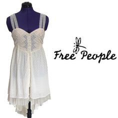 NWT free people high low dress New Romantics from free people.  This flowy cream button up, high/low dress has elastic button closure so there is a bit of stretch to it.  Semi sheer cotton with tulle lined at hem. Free People Dresses High Low