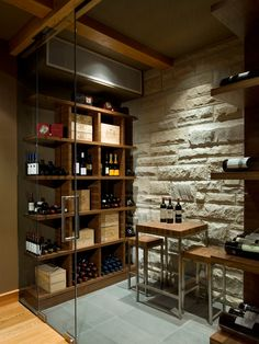Contemporary Residence Employing Natural Elements : Wine Cellar Design Showing Exposed Stone Wall Also Glass Door Open Wooden Storage Ideas Kadenwood Residence