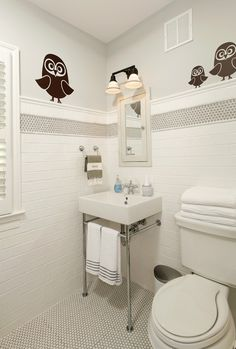 white subway tile bathroom with gray penny tile stripe