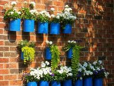 thinking OUTSIDE with old cans...this is kinda cute, wonder about rust staining the brick, but cute none the less...maybe for a special event