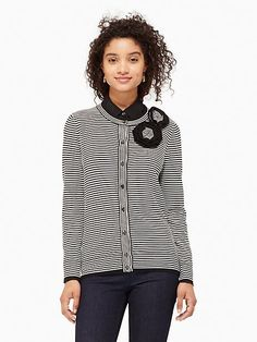 a simple striped cardigan adorned with matching rosettes, this pretty little cover-up will pair perfectly with basics like black trousers and pencil skirts.