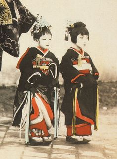 """Kamuro,"" or prostitutes in training. Sold by their poor parents at around age five to a high class prostitute (oiran), they had to work as her servant until ready to become prostitutes themselves. High class if ""successful."" Sinking lower into brothels if not .Semi-slavery enforced by the Japanese government, which assisted in the recapture of any escapees from ""the pleasure quarters."""