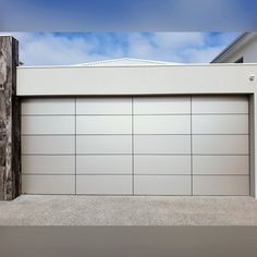 Loving the negative detail look of our Architectural Series garage doors! 😍 Pictured with Champagne Metallic aluminium composite sheeting and a Monument frame. Sectional Garage Doors, Sheet Metal, Champagne, Metallic, Minimalist, Detail, Architecture, Frame, Arquitetura