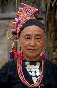 **Laos | Akha Pala women dressed in colourful traditional costume. Ban Pakha, Muang Khoua district, Phongsali, Phongsali district | ©Imagebrokerrm