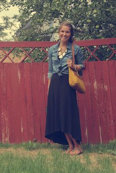cute outfit: high low dress, tied chambray shirt, bold necklace, sandals