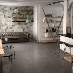 Enjoy the distinct look of stained concrete floors with the added durability of porcelain with Forte, a bold new series of cement-look porcelain that combines the contemporary look of concrete that has Concrete Look Tile, Stained Concrete, Concrete Floors In House, Cement, Dark Kitchen Floors, Kitchen Flooring, Dark Tile Floors, Kitchen Tile, Kitchen Colors