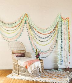 A bright array of geometric garlands are an easy way to add some pop to a plain wall.