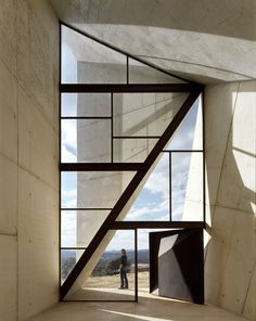 Amazing window design, great use of individual geometric glass shapes creating an effective overall floor to ceiling pattern