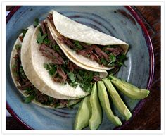 Beef Brisket Tacos INGREDIENTS: 2-4 pounds beef brisket, fat trimmed  2 ounces/pound of liquid smoke (recommend Claude's Brisket Marinade Sauce)  2 bay leaves  1 (12-ounce) beer  Corn tortillas  Salt to taste  Pepper to taste  Topping Options  Grated cheese  Crema Mexicana  Cilantro  Onions  Avocado slices  Salsa  DIRECTIONS: Place all the ingredients into the slow cooker and marinate overnight.  Cook on low for 8 to 10 hours.  Remove the brisket and shred the meat.