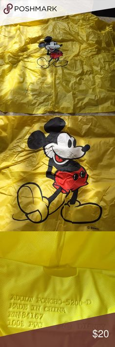 Disney bright yellow Mickey Mouse adult OS poncho No this wasn't bought for an adult but it was raining at Disney and this was the most packable answer! Probably is designed to fit a large person but it covered my kids from head to toe and that was fine by me! Snaps are clear silicone and super fast to put on while traveling Disney Jackets & Coats Capes