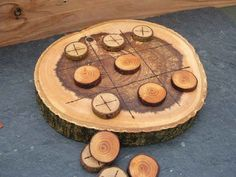 Stump Tic-Tac-Toe. This made me think it could be fun to do this on an old tree stump outside that you never got around to removing... leave it in the ground and use it for some awesome outdoor fun! Could also paint it into a chess/checkers board, just put a chair on either side of the stump and violaaa no table needed