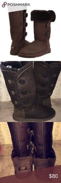 Tall brown Bailey button uggs Great boots, fur is still nice and fluffy. Flaws are fading on the heels and small hole on the toe of the left boot (which could be fixed). UGG Shoes Winter & Rain Boots