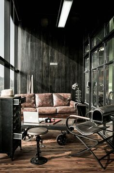 Metal, leather, and wood- what could be more masculine? Great industrial look for this seating area.