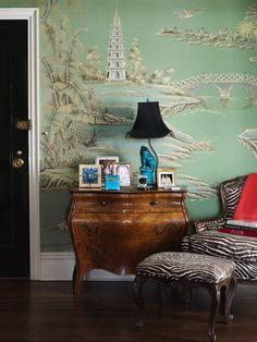 Chinoiserie Wallpaper in green & animal print chair