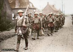 THE GERMAN SPRING OFFENSIVE, MARCH-JULY 1918  Battle of the Lys: Men from a battalion of the 55th Division marching through Béthune, Pas-de-Calais, France on their way back from the trenches for rest, 10 April 1918.  (Source © IWM Q 342) Consolé, Armando (Second Lieutenant) (Photographer)