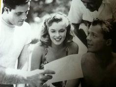 "Marilyn reading a letter on set of ""Scudda Hoo! Scudda Hay!"""