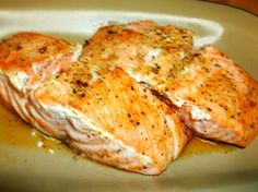 This is my own quick and easy recipe for a very moist, buttery baked salmon. It is lightly flavored with Old Bay seasoning, a touch of lemon and garlic and herbs. Don't shy away from trying this because of the amount of butter used. Most of the butter remains in the pan. I serve it with a baked potato, romaine salad and cheddar chive biscuits. Simply delicious. Also, there is almost no clean-up!