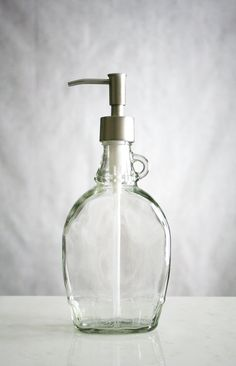 my fave glass bottle i just screwed on old soap pump n wa la same effect :) pretty dispenser for soap or rubbing alchol