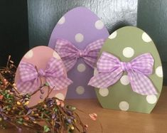 Our set of 3 Easter egg trio is adorable. 5 to 8 tall, adorned with matching ribbons and polka dots! Easter Projects, Easter Crafts For Kids, Easter Ideas, Spring Crafts, Holiday Crafts, Easter Coloring Pages, Diy Easter Decorations, Outdoor Decorations, Easter Centerpiece
