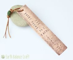 Trees are poems the earth writes to the sky. Hand stamped rustic copper bookmark.