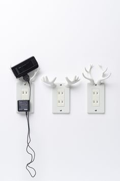 socket-deer  2008.07 for AU These electrical outlet covers let you put your mobile phone on the wall as it recharges. The antlers for all three types of deer are already the perfect shape to hold things, so we hardly had to modify the forms at all.