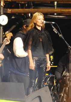 Pin for Later: Kate Moss, Patron Saint of Glastonbury Style  For a spot on stage with then-boyfriend Pete Doherty's band, Kate went for the rocker look with skinny leather jeans and a capelet.
