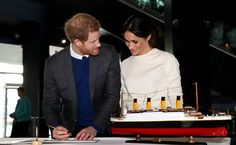 Prince Harry looks lovingly at his bride-to-be as they sign the visitor book at the Titani...