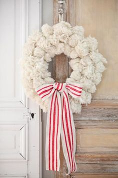 What a beautiful twist on the traditional Christmas wreath! The candy cane inspired colors give it a fun and playful feel. Too cute!