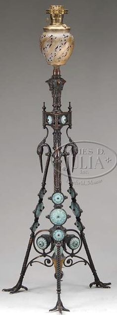 A bronze floor lamp, classic design with three legs ascending from cast turkey feet, R. Hollings & Co., art pottery tiles made by J & J Low Art Tile Works | JV