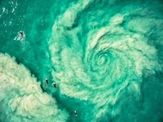 earth-from-above-drone-surf - surfers avoiding the hurricane rip in Western Australia