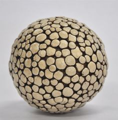 Polka Dot Ceramic Ball Rattle by Kelly Jean Ohl. This is a hand carved ceramic ball rattle.: