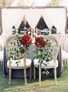 romantic red peonies and vines decorating the Bride and Groom's chairs | Photography: Braedon Photography