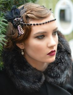 Handmade Gatsby inspired Headpiece with lots of sparkle and feathers.    This headpiece is:    -made by hand  -features black peacock, guinea,