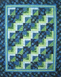 """This pattern is for aquick and easy quilt in two sizes. The lap size (62 1/2"""" x 78 1/2"""") has 8"""" squares. The queen size (92"""" x 102"""") has 10"""" squares. Beginner Friendly."""