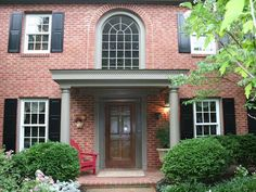 This front portico covers the large brick patio of a traditional colonial in McLean, VA Portico Entry, Front Door Entrance, Front Entrances, Front Entry, Brick Porch, Porch Roof, Exterior House Colors, Colonial Exterior, Exterior Doors