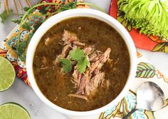 Slow Cooker Tomatillo Pork Chile Verde (sub garlic-infused oil for the garlic; sub scallions for the onion) / PaleOMG
