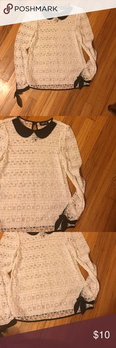 """Boutique buy 🎊collared blouse White lace material with black attached """"collar"""" that sits nicely on the neckline. Black ties on either arm. Brand is Fab'rik and the size is small. Fab'rick Tops Blouses"""